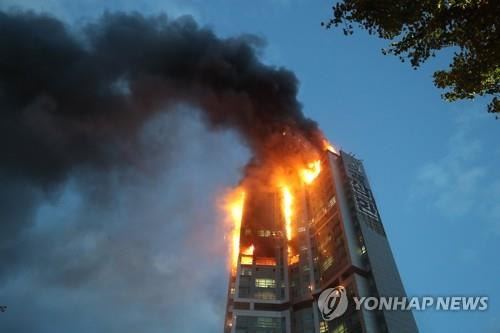South Korean tower block engulfed in flames