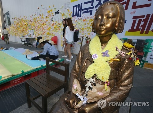 This photo taken on May 20, 2016, shows the life-size statue of a girl symbolizing South Korean victims who were sexually enslaved by Japanese troops during its occupation of the Korean Peninsula (1910-45) in front of the Japanese Embassy in central Seoul. (Yonhap)