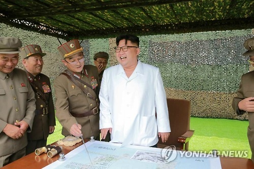 (3rd LD) N.K. leader observes missile launches, calls for stronger nuke force - 1