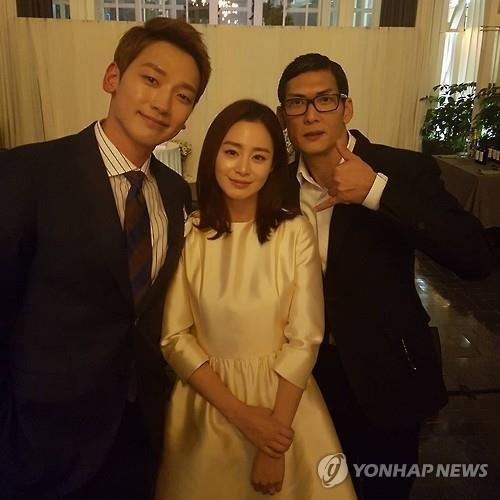 The photo, taken from singer Park Joon-hyung's Instagram on Feb 4, 2017, shows Rain (L), Kim Tae-hee and Park Joon-hyung at the wedding reception on Jan. 19, 2017. (Yonhap)