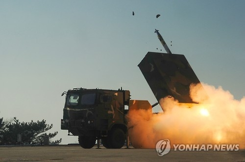 This file photo shows South Korea's Chunmoo multiple rocket launcher being fired during training. (Yonhap)