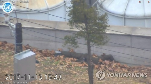 A North Korean defector lies next to a wall after being shot by fellow troops during his defection to South Korea in this photo captured from a CCTV clip provided by the U.N. Command on Nov. 22, 2017. (Yonhap)
