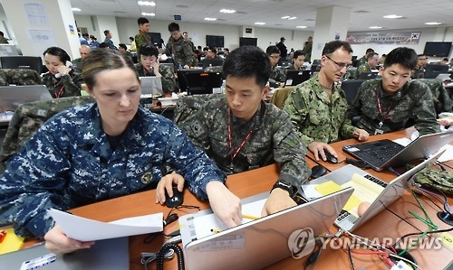 South Korean and U.S. soldiers hold a combined Key Resolve command-post exercise in this photo provided by South Korea's military. (Yonhap)