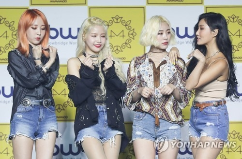 "Members of K-pop group Mamamoo pose for photos during a media showcase for their new album, ""Yellow Flower,"" on March 7, 2018, at Yes24 MUV Hall in western Seoul. (Yonhap)"