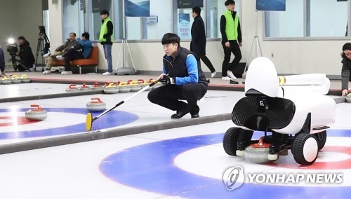 Human players beat AI robots in curling game0