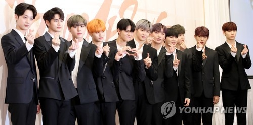 Singers of project K-pop group Wanna One pose for photos during a press conference for their new EP on March 19, 2018, at Stanford Hotel in western Seoul. (Yonhap)