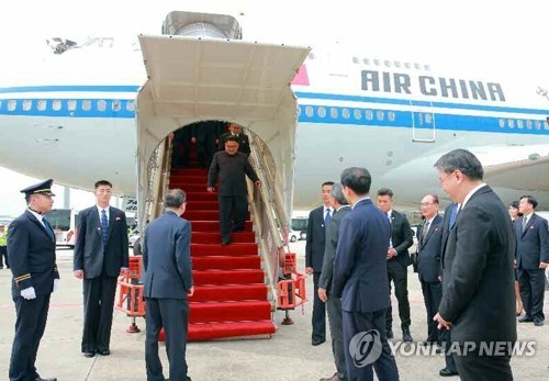 In this photo released by North Korea's media, leader Kim Jong-un arrives at a Singaporean airport on June, 10, 2018. (For Use Only in the Republic of Korea. No Redistribution) (Yonhap)