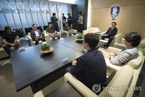 In this file photo taken July 5, 2018, members of the Korea Football Association's national team coach appointment committee attend a meeting in Seoul. (Yonhap)