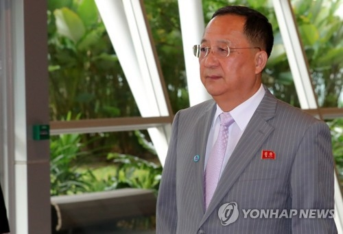 North Korean Foreign Minister Ri Yong-ho walks to a meeting venue at the Singapore EXPO convention center on Aug. 3, 2018. (Yonhap)