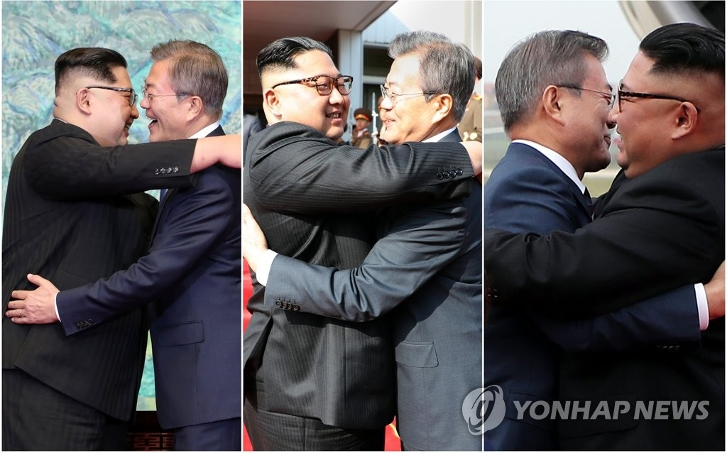 This combined file photo shows South Korean President Moon Jae-in embracing North Korean leader Kim Jong-un during their first and second summit talks at the truce village of Panmunjom in April (L) and May 2018 (C), respectively. Moon and Kim embraced each other again at Pyongyang's Sunan International Airport on Sept. 18 (R), after Moon arrived in the North Korean capital for a three-day visit for his third summit with Kim. (Pool photo) (Yonhap)