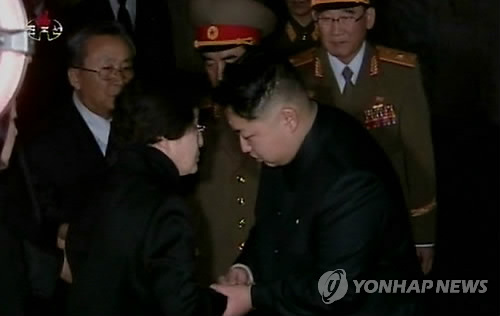 This image captured from footage on North Korean state television shows former South Korean first lady Lee Hee-ho (L) expressing her condolences to Kim Jong-un upon the death of his father and then-North Korean leader Kim Jong-il in Pyongyang in December 2011. (Yonhap)