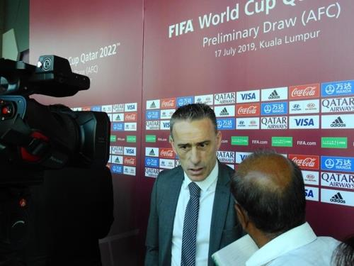 Paulo Bento (L), head coach of the South Korean men's football team, speaks to reporters at the Asian Football Confederation House in Kuala Lumpur on July 17, 2019, after the draw for the second round of the Asian qualification for the 2022 FIFA World Cup. (Yonhap)