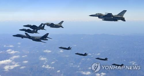 A B-1B Lancer strategic bomber; two F-35A and two F-35B stealth jets of the U.S.; and two F-16K and two F-15K fighters of South Korea fly in formation over the Korean Peninsula in an annual joint Korea-U.S. air force drill, Vigilant Ace, on Dec. 6, 2017, in this photo provided by the Air Force. The exercise against North Korean provocations was the biggest in its history. (Yonhap)
