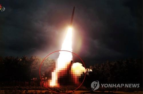 This blurred photo, captured from the North's Korean Central TV on Aug. 1, 2019, shows the North's newly-developed large-caliber multiple launch guided rocket system. The system was test-fired the previous day. (For Use Only in the Republic of Korea. No Redistribution) (Yonhap)