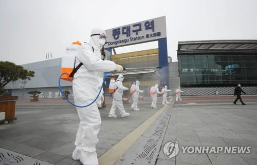 Quarantine officials carry out a disinfection operation in Daegu, 300 kilometers south of Seoul, on Feb. 29, 2020, to fight the spread of the new coronavirus in the city. (Yonhap)