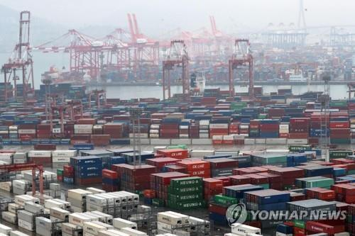 This file photo, taken Dec. 1, 2019, shows stacks of export-import containers at South Korea's largest port in Busan, 450 kilometers south of Seoul. (Yonhap)
