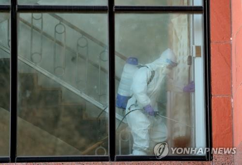 Disinfection work is carried out at a nursing hospital in this undated Yonhap file photo. (Yonhap)