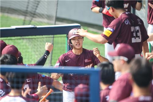 Byeon Sang-kwon of the Kiwoom Heroes (C) is congratulated by his teammates after scoring a run against the LG Twins during a Korea Baseball Organization regular season game at Jamsil Stadium on May 17, 2020, in this photo provided by the Heroes. (PHOTO NOT FOR SALE) (Yonhap)