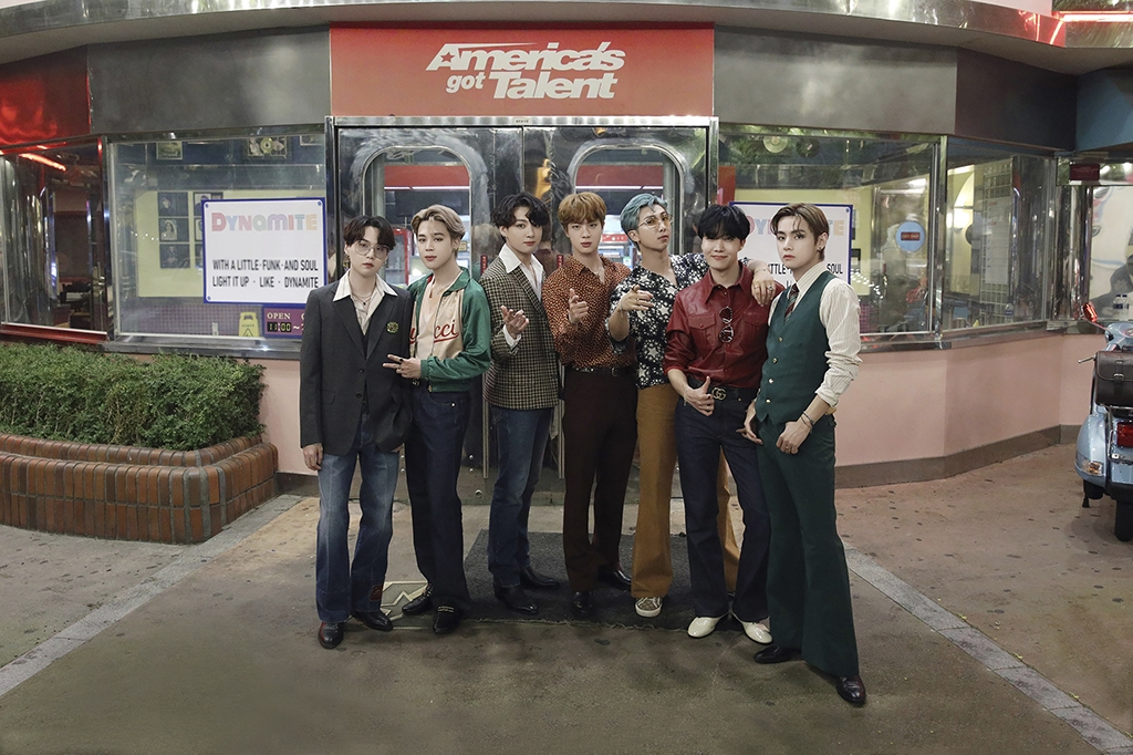 "This photo provided by Big Hit Entertainment on Sept. 17, 2020, shows members of BTS posing for a photo at the location for filming a performance of ""Dynamite"" for NBC's ""America's Got Talent."" (PHOTO NOT FOR SALE) (Yonhap)"