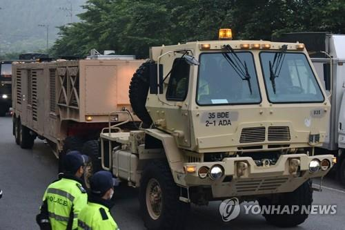 Military vehicles transport equipment to the site of the Terminal High Altitude Area Defense (THAAD) base in the town of Seongju, about 220 km south of Seoul, on May 29, 2020, as part of an upgrade, in this photo released by a group of residents and activists opposing the installation of the missile defense system. (PHOTO NOT FOR SALE) (Yonhap)