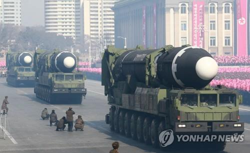Hwasong-15 missiles on mobile launchers are displayed during a military parade at Kim Il-sung Square in Pyongyang on Feb. 8, 2018, in this photo released by the North's official Korean Central News Agency the next day. (For Use Only in the Republic of Korea. No Redistribution) (Yonhap)