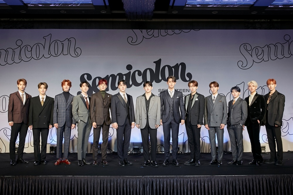 This photo provided by Pledis Entertainment on Oct. 19, 2020, shows members of K-pop group Seventeen posing for photos during an online showcase held at Coex Inter-Continental Hotel in southern Seoul. (PHOTO NOT FOR SALE) (Yonhap)
