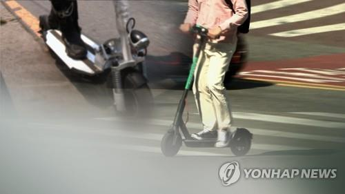 This image filed on March 11, 2020, shows people riding e-scooters. (Yonhap)