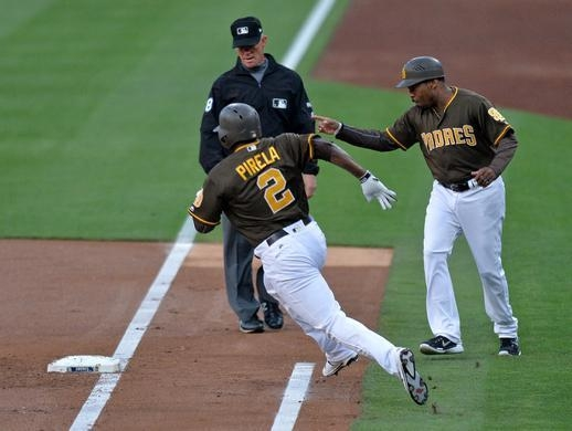 Johnny Washington (R), then first base coach for the San Diego Padres, points to second base as Jose Pirela makes the turn, in this 2017 file photo provided by Washington. (PHOTO NOT FOR SALE) (Yonhap)