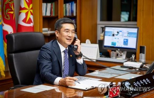 This Oct. 8, 2020, file photo, provided by the Ministry of Defense, shows South Korean Defense Minister Suh Wook holding phone talks with then U.S. defense chief Mark Esper at his office in Seoul. (PHOTO NOT FOR SALE) (Yonhap)