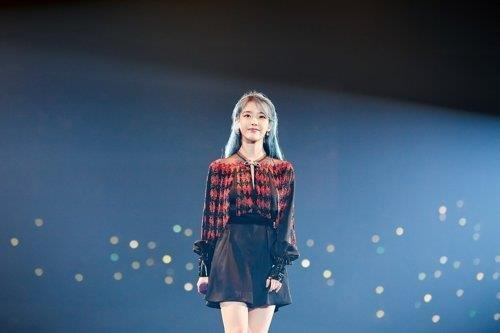 This photo, provided by Kakao M Corp., shows K-pop songstress IU. (PHOTO NOT FOR SALE) (Yonhap)