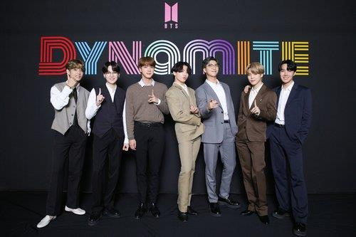 "This photo, provided by Big Hit Music, shows the members of BTS posing for photos during an online media day event in Seoul on Sept. 2, 2020. The band's ""Dynamite"" topped Billboard's main Hot 100 singles chart in the United States on Aug. 31. (PHOTO NOT FOR SALE) (Yonhap)"