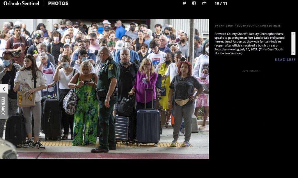 폭탄 소동에 대피하는 공항 이용객들