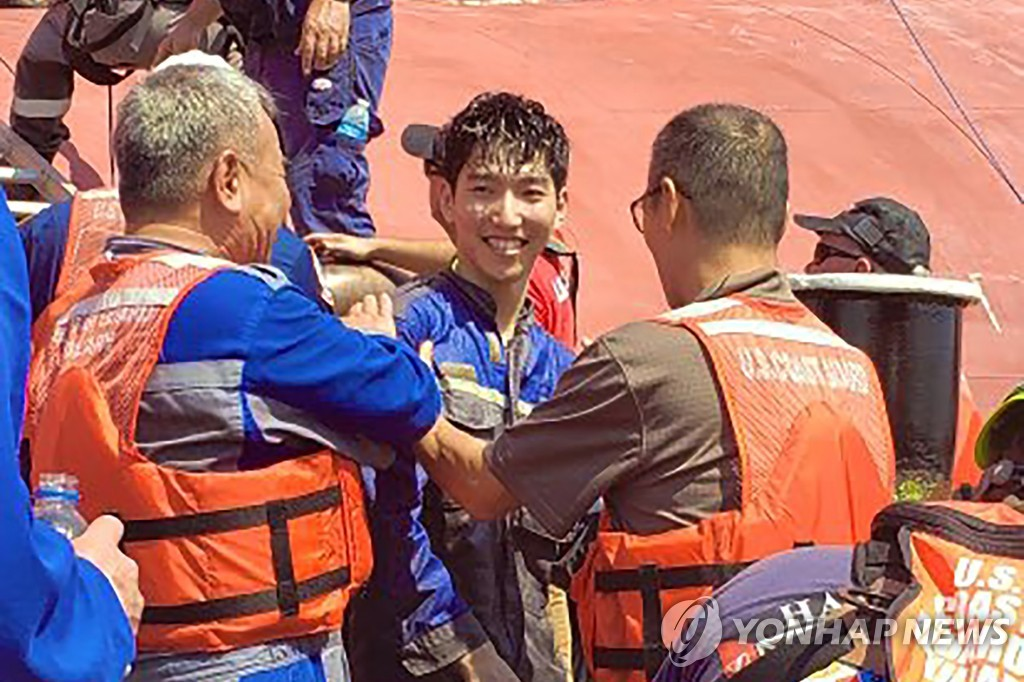 This image released by the U.S. Coast Guard via AP shows a crew member of the cargo ship Golden Ray as he is helped off the capsized ship on Sept. 9, 2019. (Yonhap)