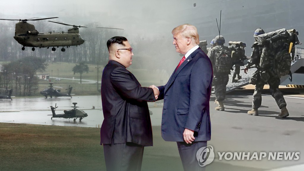 This image, provided by Yonhap News TV, shows U.S. President Donald Trump (R) and North Korean leader Kim Jong-un. (Yonhap)