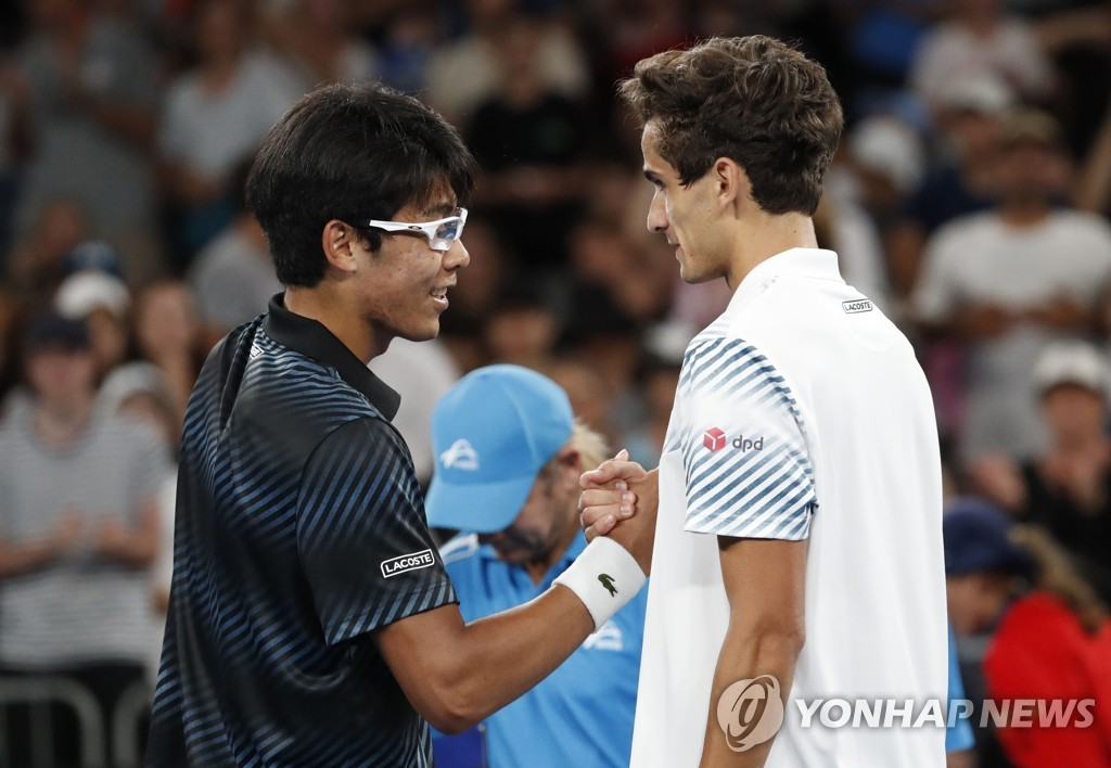 In this Reuters photo, Chung Hyeon of South Korea (L) and Pierre-Hugues Herbert of France shake hands after their second-round match in the men's singles at the Australian Open at Melbourne Arena in Melbourne on Jan. 17, 2019. (Yonhap)