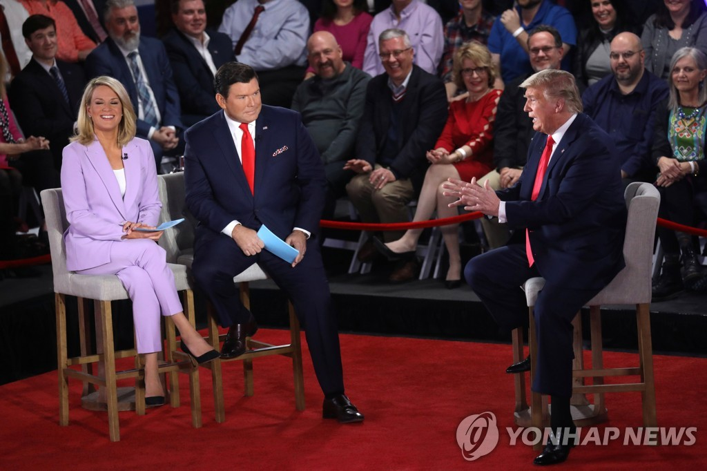 This Reuters photo shows U.S. President Donald Trump participating in a FOX News Channel town hall event with moderators Bret Baier and Martha MacCallum at the Scranton Cultural Center in Scranton, Pennsylvania, on March 5, 2020. (Yonhap)