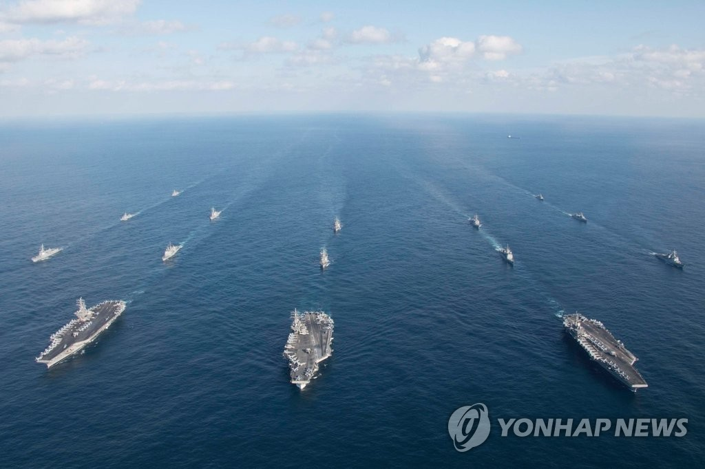 This file photo, taken from the U.S. 7th Fleet's Facebook account on Nov. 12, 2017, shows three U.S. aircraft carriers -- USS Ronald Reagan, USS Nimitz and USS Theodore Roosevelt -- as they were on an unprecedented joint exercise mission with the South Korean Navy in the East Sea. (Yonhap)