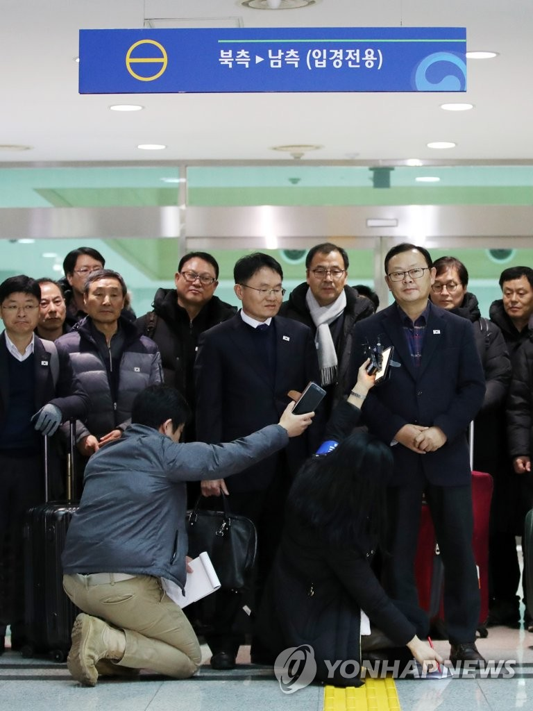 This photo provided by the Joint Press Corps shows a group of South Korean officials and railway experts speaking to reporters after returning home on Dec. 5, 2018, following a six-day railway inspection in North Korea. (Yonhap)