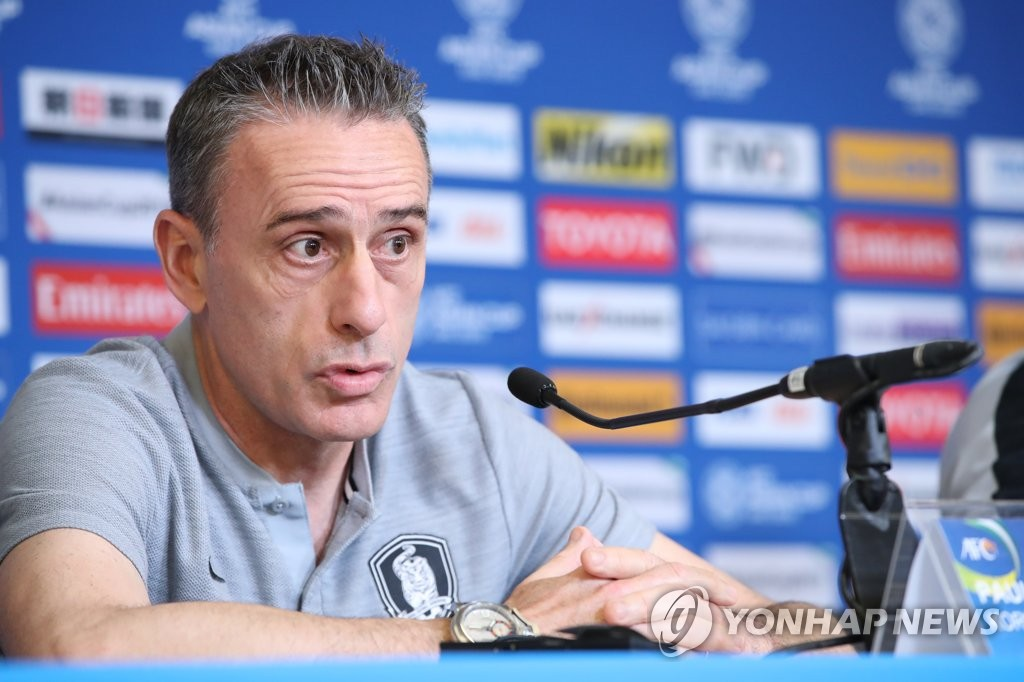 Paulo Bento, head coach of the South Korean men's football team, speaks at a press conference ahead of the team's match against Kyrgyzstan at the Asian Football Confederation Asian Cup at Hazza Bin Zayed Stadium in Al Ain, the United Arab Emirates, on Jan. 10, 2019. (Yonhap)