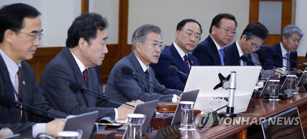 President Moon Jae-in (third from L) speaks in a weekly Cabinet meeting held at his office Cheong Wa Dae in Seoul on Feb. 12, 2019. (Yonhap)