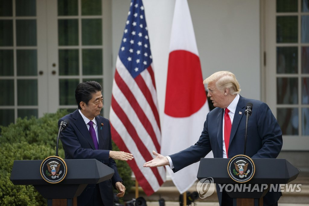 This EPA photo shows Japanese Prime Minister Shinzo Abe (L) meeting with U.S. President Donald Trump at the White House in Washington on June 7, 2018. (Yonhap)