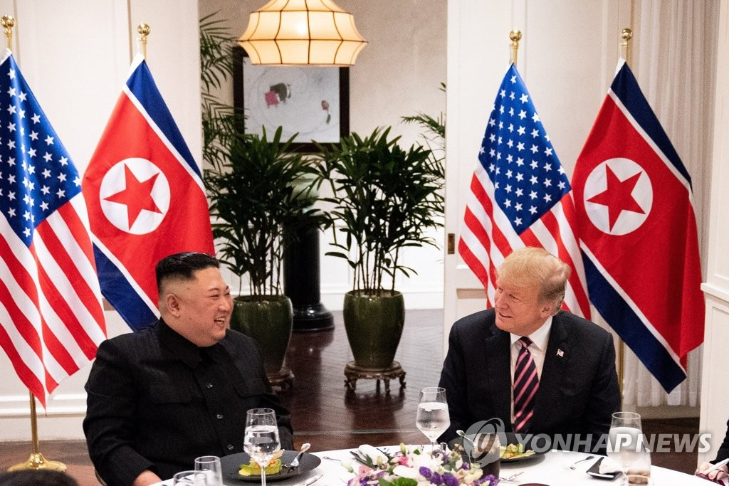 U.S. President Donald Trump and North Korean leader Kim Jong-un smile during a dinner at the Sofitel Legend Metropole hotel in Hanoi on Feb. 27, 2019, in this photo captured from the Twitter account of the White House. (Yonhap)