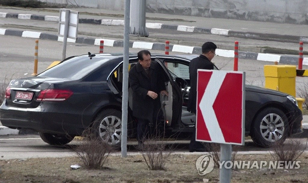 Kim Chang-son (L), a North Korean official with the North's State Affairs Commission, gets out of a vehicle at Sheremetyevo International Airport in Moscow, Russia, on March 23, 2019. (Yonhap)