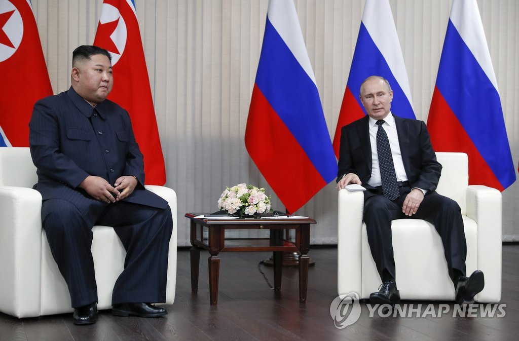 This AP photo shows North Korean leader Kim Jong-un (L) and Russian President Vladimir Putin holding their first summit in Russia's Far East city of Vladivostok on April 25, 2019. (Yonhap)