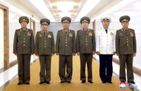 (LEAD) N. Korea, China demonstrate military ties in high-level talks