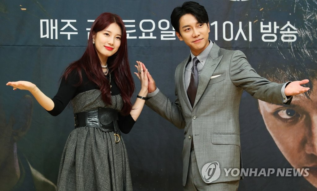 "Actress Bae Suzy (L) and actor Lee Seung-gi pose at a press conference for SBS spy action drama ""Vagabond"" in Seoul on Sept. 16, 2019. (Yonhap)"