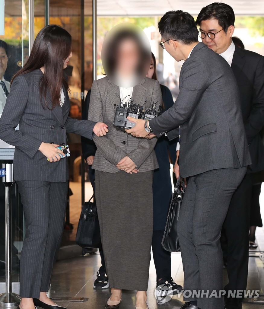 Ex-justice minister's wife at arrest hearing