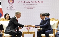 Moon revs up ASEAN diplomacy, breaks ice with Abe