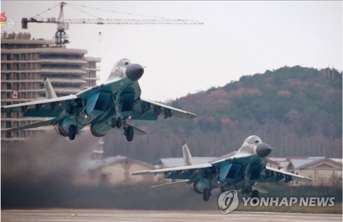 N. Korean leader watches air show, calls for readiness to fight enemies