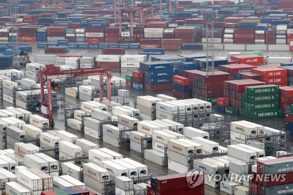 The file photo shows stacks of import-export cargo containers at South Korea's largest seaport in Busan, located some 450 kilometers south of Seoul. (Yonhap)